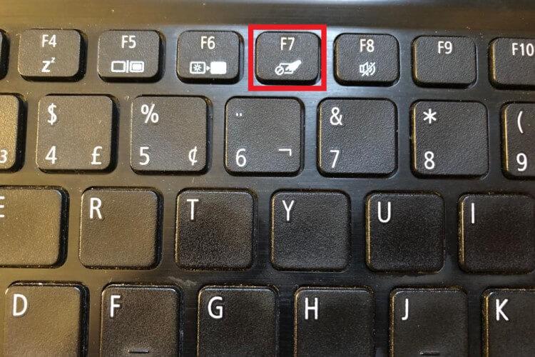 Detalhe da tecla de função de ativação do touchpad.